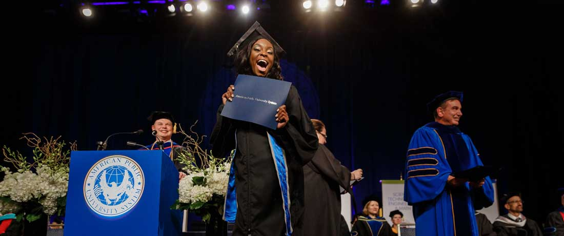 Photo of a student graduating at APUS.